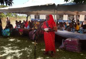 Msambweni Sub-county Maendeleo ya Wanawake Chairperson, Zeituni Bakari Semayote addressing participants during the International Women's Day at Nyumba Mbovu in Kinondo Ward, Msambweni Sub-county